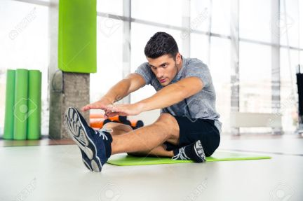 45024728-Portrait-of-a-fitness-man-doing-stretching-exercises-at-gym-Stock-Photo