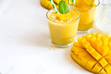 54964044-Healthy-drink-with-yogurt-and-mango-sample-text-background-Stock-Photo
